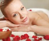 Beautiful young woman getting spa massage — Stock Photo