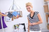 Modern young fashion designer working at studio. — Stock Photo