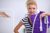Smiling fashion designer standing near mannequin in office — Foto de Stock
