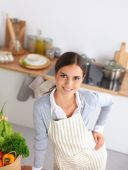 Woman making healthy food standing smiling in kitchen — Stock Photo