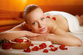 Beautiful young woman getting spa massage — Stock Photo