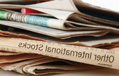 Newspapers stack on white background. — Stock Photo