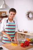 Smiling woman preparing salad in the kitchen — Stock Photo