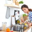 Young woman in the kitchen preparing a food — Stock Photo #57561697