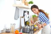 Young woman in the kitchen preparing a food — Stock Photo