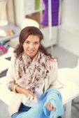 Portrait of beautiful female fashion designer working — Stock Photo