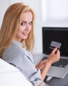 Woman shopping online with credit card and computer. — Stockfoto