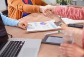 Business people handshake, sitting in the office — Stock Photo