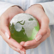 Woman holding globe in her hand on white — Stock Photo #59131665