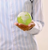 Hands holding a green earth — Stock Photo