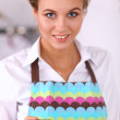 Woman preparing salad in the kitchen, using a phone — Stock Photo #62729273