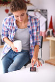 Young woman reading mgazine In kitchen at home — Stockfoto