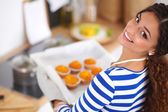 Woman is making cakes in the kitchen — Foto Stock