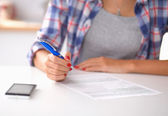 Young woman writing something in her note pad — Stock Photo