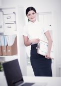 Portrait of a young woman working at office — Stock Photo