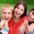 Three happy girls pointing fingers at you choosing — Stock Photo #67655491