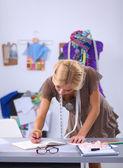 Young fashion designer working at studio. — Stock Photo