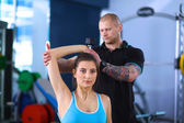 Gym woman personal trainer man. — Stockfoto