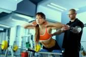 Gym woman personal trainer man. — Zdjęcie stockowe