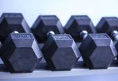 Sports dumbbells in modern sports club — ストック写真