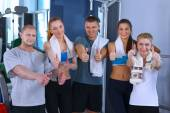 People at the gym standing together and showing ok — Stock Photo