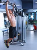 Young man training at gym with exercises — 图库照片