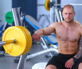 Young handsome man sits after workout in the gym — Stock Photo