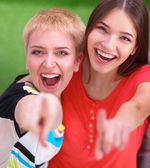 Three happy girls pointing fingers at you choosing — Stock Photo