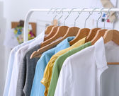 Clothes hang on a shelf in  designer clothes store — Stock Photo