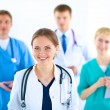 Attractive female doctor in front of medical group — Stock Photo #73506783