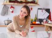 Smiling attractive woman having breakfast in kitchen interior — Foto Stock