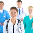 Attractive female doctor in front of medical group — Stock Photo #74080935