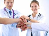 Doctors and nurses in a medical team stacking hands — Stock Photo