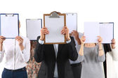 Team of businesspeople holding a folders near face isolated on white background — Stock Photo
