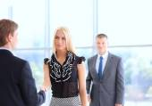 Business people shaking hands after meeting — Stock Photo