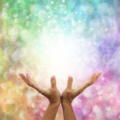 Rainbow healing energy on bokeh background — Stock Photo