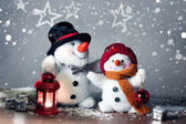 Two smiling snowmen  in the snow, no name toy — Stock Photo