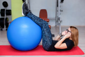 Woman training abdominal with healhy ball — Stock Photo