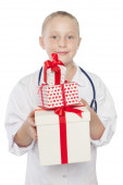 Cute little girl dressed like a doctor ,holding gift box — Stock Photo