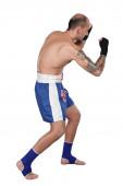 Thai boxer with thai boxing action — Stock Photo