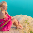 Portrait of a beautiful sexy girl with blonde hair sitting near the lake — Stock Photo #52892697