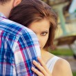 Beautiful happy couple in love standing near the old planes hugging the girl looks over the shoulder of the guy — Stock Photo #55857265