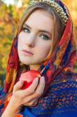 Beautiful young sweet girl in a headscarf with the rim on the head with a red Apple in his hand, like a fairy tale character with blue eyes — Stock Photo
