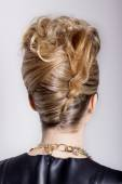 Beautiful woman with evening salon hairdo. Complicated hairstyle for party — Stock Photo