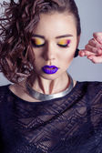 Fashion capture beautiful sexy girl with bright makeup, big full lips with purple lipstick, beautiful hair. Photography makeup, beauty, bright eye shadow — Stock Photo