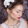 Beautiful young elegant girl with bright makeup with red lips with a beautiful wedding hairstyle for the bride with white flowers in her hair, stylish way — Stock Photo #67091873