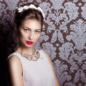 Beautiful young sexy elegant woman with red lips, beautiful stylish hairstyle with white flowers in her hair, the way for the bride at a wedding — Stock Photo