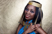 Beautiful dark-skinned girl black woman in the image of the Egyptian queen with red lips bright makeup demonstrates long nails — Stock Photo
