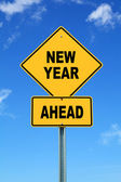 Yellow cautionary road sign new year ahead — Stock Photo