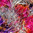 Festive multi-colored background with Christmas tinsel — Stock Photo #59400165